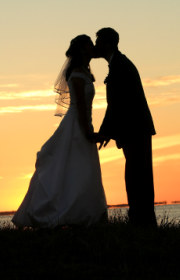 bride and groom silhouette in sunset