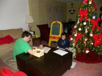 nick and maya playing school at Christmas time