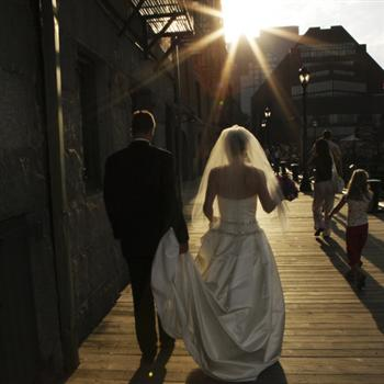 outdoor wedding couple walking towards the sunset